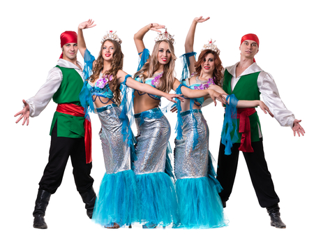 adult mermaid: Carnival dancer team dressed as mermaids and pirates. Retro fashion style, isolated on white background in full length. Stock Photo
