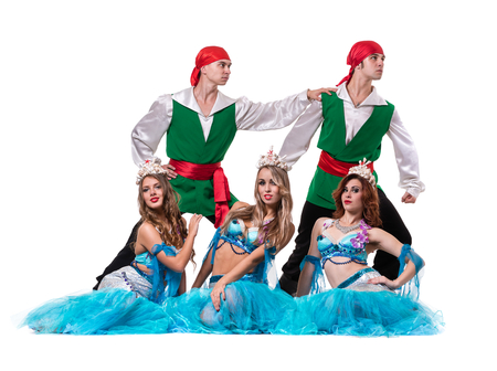 undine: Carnival dancer team dressed as mermaids and pirates. Retro fashion style, isolated on white background in full length. Stock Photo