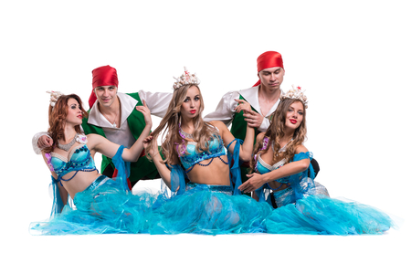 seamaid: Carnival dancer team dressed as mermaids and pirates. Retro fashion style, isolated on white background in full length. Stock Photo