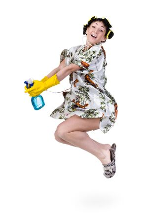 cleaning debt: Housewife with curlers in her hair and a bathrobe jumping, isolated on a white background.