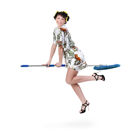 homemaker: homemaker on a broom against isolated white background Stock Photo