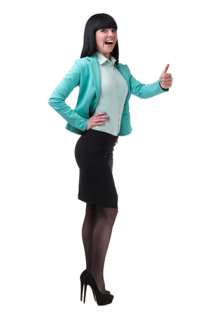 body image: Successful young business woman happy for her success. Isolated full body image on white background. Caucasian businesswoman.