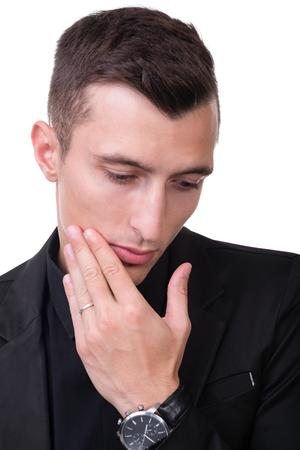 sad man alone: Closeup portrait of sad and depressed man isolated on white studio shot Stock Photo