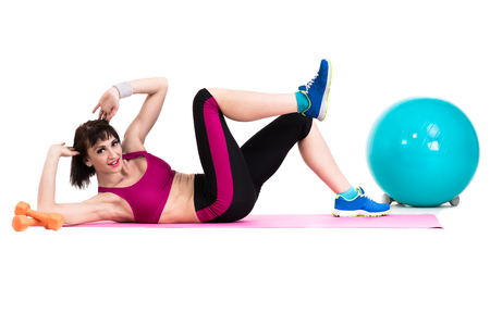 fitball: Young smiling woman makes exercise with fitball, full length portrait isolated over white background