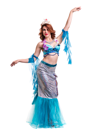 seamaid: Carnival dancer woman dressed as a mermaid posing, isolated on white background in full length.