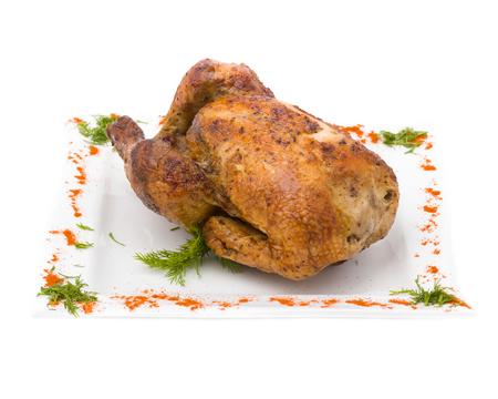 karkas: gebakken gebakken kip karkas op een witte achtergrond