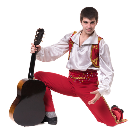 toreador: Dancing man wearing a toreador costume with guitar. Isolated on white background in full length. Stock Photo