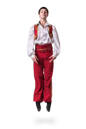 toreador: Jumping man wearing a toreador costume. Isolated on white background in full length. Stock Photo