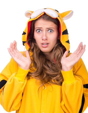 panicked: portrait of scared young woman in the tiger costume isolated on white studio shot Stock Photo