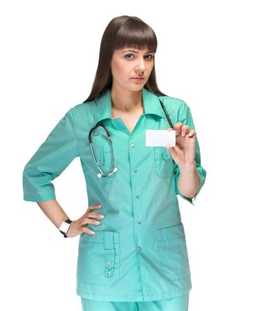 commercial medicine: Medical sign. Young woman doctor or nurse showing empty blank clipboard sign with copy space for text. Caucasian female model isolated over white background.