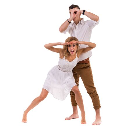rummage: Surprised young couple. Portrait of amazed couple against isolated white background in full length with copyspace