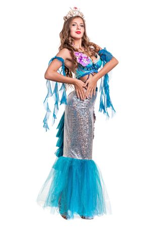 water nymph: Carnival dancer girl dressed as a mermaid posing, isolated on white background in full length. Stock Photo