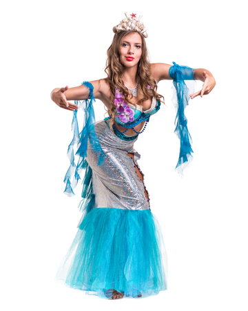 seamaid: Carnival dancer girl dressed as a mermaid posing, isolated on white background in full length. Stock Photo