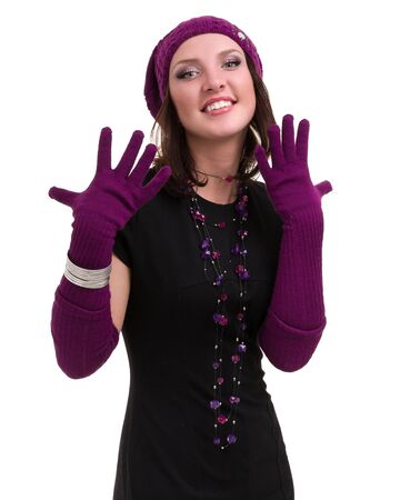 knitwear: knitwear. young woman wearing a winter cap and gloves isolated on white background Stock Photo