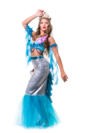 water nymph: Carnival dancer woman dressed as a mermaid posing, isolated on white background in full length.