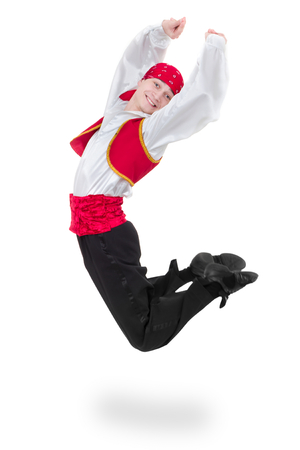 toreador: Dancing man wearing a toreador costume jumping. Isolated on white background in full length. Stock Photo