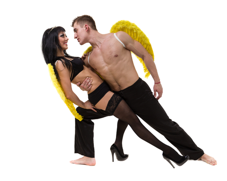 attractive angels: Attractive young Halloween couple dressed as angels, isolated on white background in full length.