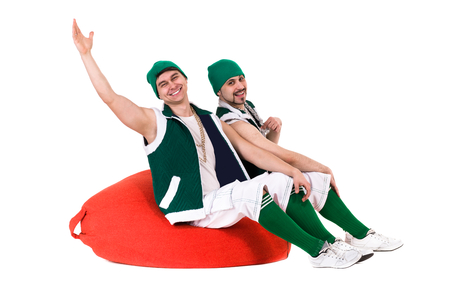 friendly people dressed like a gnomes have fun and enjoy. Isolated on white background in full length.
