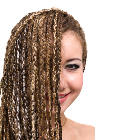 portrait of young smiling woman with dreadlocks. Stock Photo