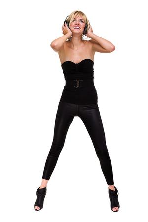 gogo girl: full length photo of attractive woman dancer with headphones, isolated on white Lizenzfreie Bilder