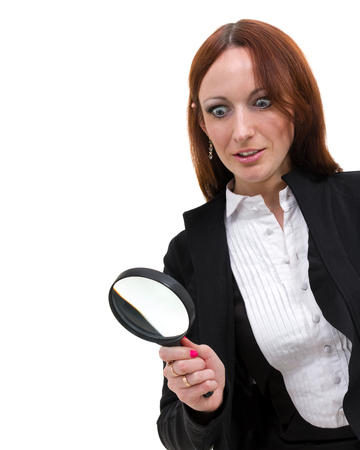 hocked woman searching finding clues with magnifying glass, isolated on white Stock Photo