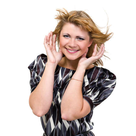 flyaway: happy young woman with flying hair on white