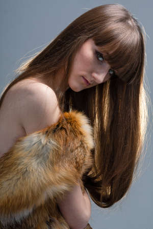 closeup portrait of glamour young girl with beautiful long hair photo
