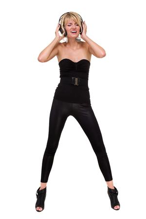 gogo girl: in voller Länge Foto der attraktiven Frau Tänzer mit Kopfhörern, isoliert auf weiß Lizenzfreie Bilder