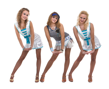 sexy girl dance: Dance team in sailor uniform posing against isolated white background Stock Photo