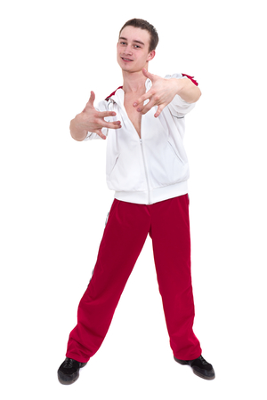 Disco dancer showing some movements against isolated white background Stock Photo