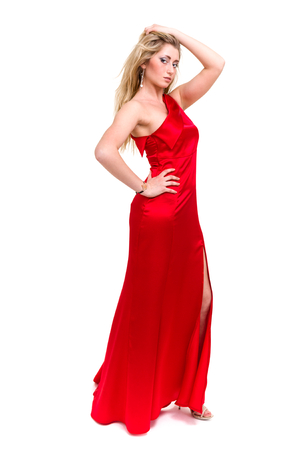 Full length shot of sexy woman in red dress, isolated on white photo