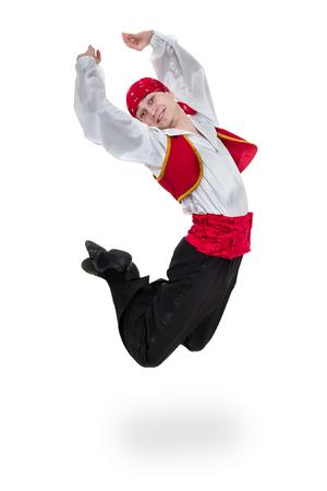 Dancing man wearing a toreador costume jumping. Isolated on white in full length.