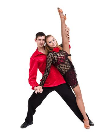 Toda la longitud de baile joven pareja de ballet contra el blanco aislado Foto de archivo