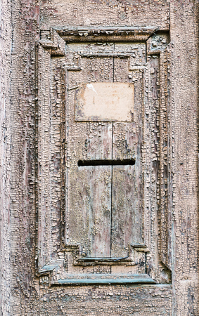 Vintage mail slot in a wooden door Stock Photo