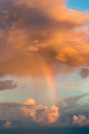 Rainbow and fantastic clouds at sunset Stock Photo