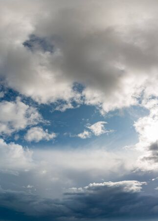 Fantastic clouds against blue sky, panorama