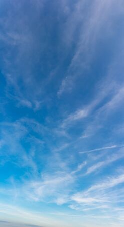 Fantastic soft clouds against blue sky, natural composition - panorama 写真素材