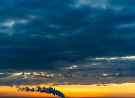 Fantastic dark blue thunderclouds at sunrise, natural composition Standard-Bild