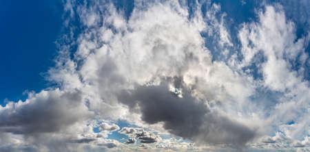 Fantastic clouds against blue sky, panorama Standard-Bild - 164721823