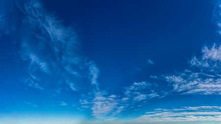 Fantastic clouds against blue sky, panorama Standard-Bild - 164721844