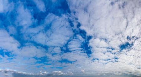 Fantastic clouds against blue sky, panorama Standard-Bild - 164721847