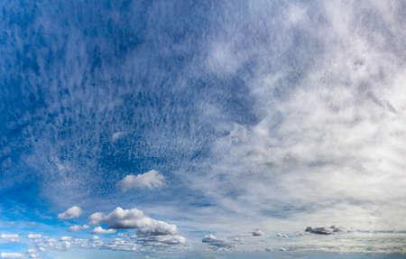 Fantastic clouds against blue sky, panorama Standard-Bild - 164721852
