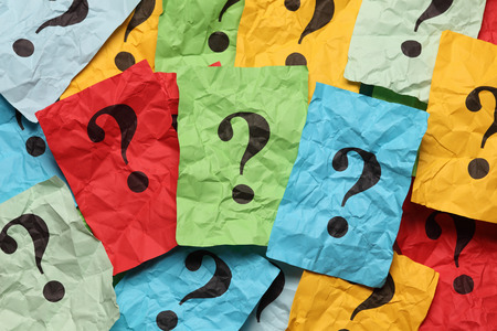 Crumpled colorful paper notes with question marks. Stock Photo - 31104541