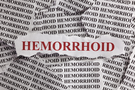 hemorrhoid: Torn pieces of paper with words Hemorrhoid