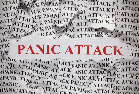 panic attack: Torn pieces of paper with the word Panic Attack. Concept Image. Close-up.