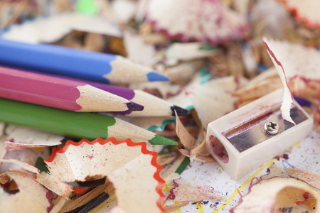 shavings: Colored pencils with pencil shavings and pencil sharpener.