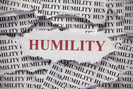 Torn pieces of paper with words Humility