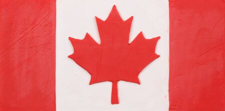 child's: Flag of Canada made of plasticine (Childs Play Clay). Close-up.