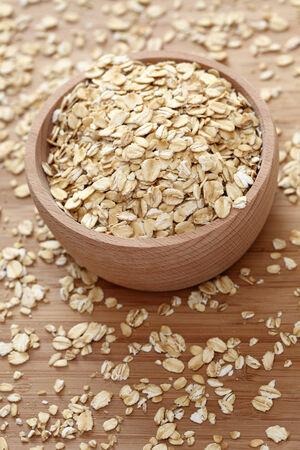 Rolled oats in a wooden bowl. Close-up. photo