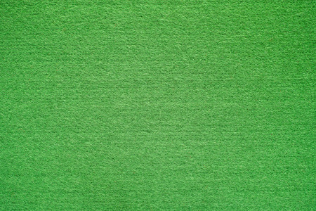 Green felt background. Stock Photo